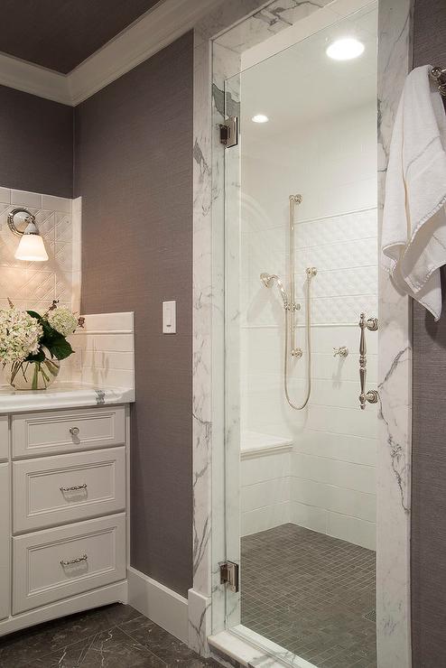 White Shower Tiles With Gray Shower Floor Transitional