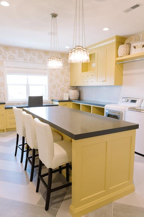 Yellow Laundry Room Cabinets With Gray Quartz Countertops