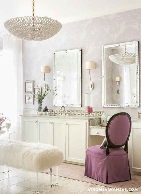 Awesome Ivory And Purple Bathroom Features Walls Clad In Purple Wallpaper Lined  With His And Hers Ivory Shaker Vanity Cabinets Under Studded Mirrors Topped  With ... Awesome Design