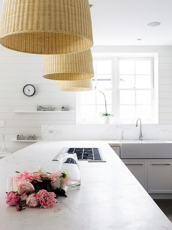 White modern kitchen with ikea light pendants modern kitchen white modern kitchen features a kitchen peninsula fitted a gas cooktop illuminated by wicker pendants ikea leran pendant lamps mozeypictures Choice Image