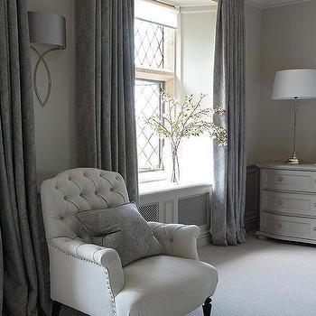 gray french bedroom features a white tufted chair lined with a gray