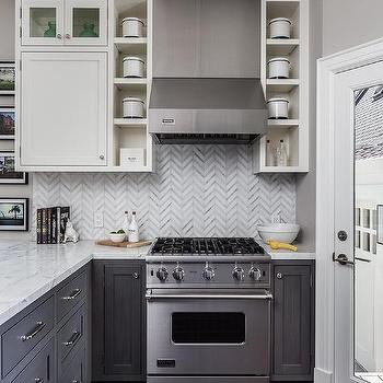 Gray distressed kitchen cabinets with marble herringbone for Viking kitchen designs