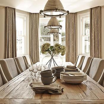 Taupe Dining Room With Bay Window