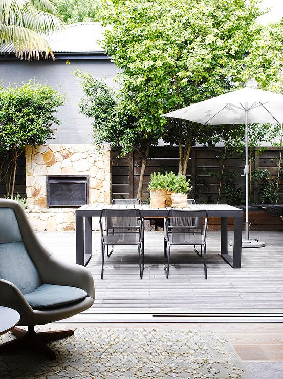 Modern Patio With Black Outdoor Dining Table And Chairs