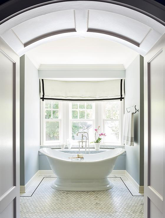 Hallway With A Barrel Ceiling Opens To A Tub Nook Filled With A Vintage  Style Tub Atop A Marble Hex Tiled Floor Placed Under Curved Windows Dressed  In A ...