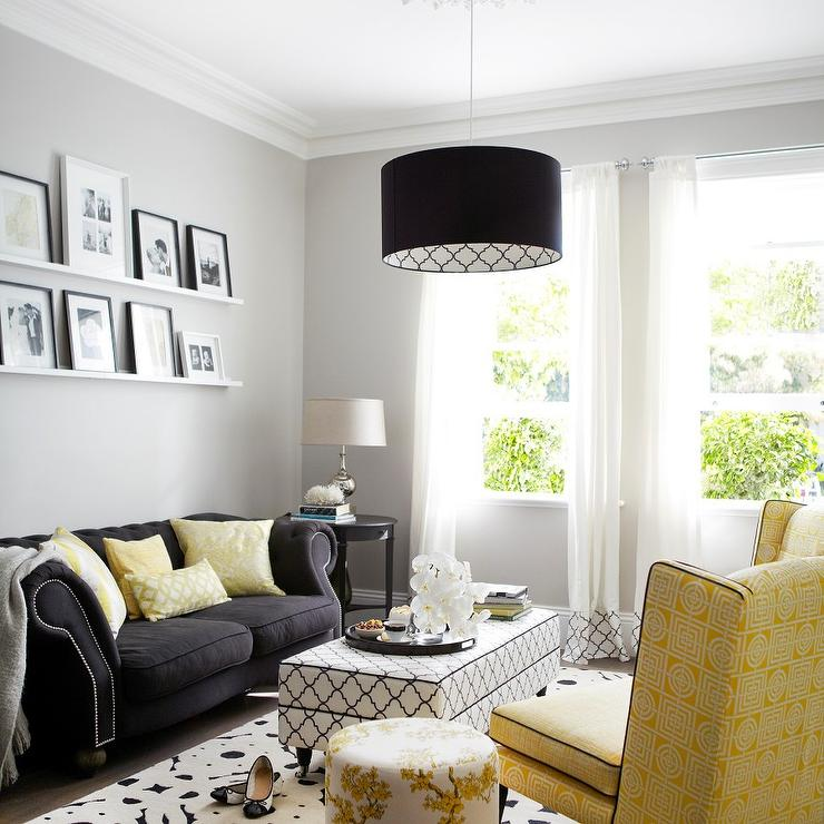 Yellow and Black Living Room with Black and White Trellis Ottoman