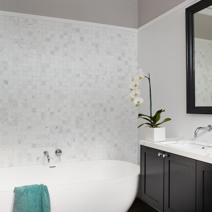 Contemporary Black And White Bathroom Features A Small Part Of An Upper  Wall Painted Warm Gray And A Large Part Of Lower Wall Painted Light Gray  Finished ...