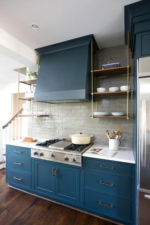 Blue kitchen cabinets with wood and brass shelves for Kitchen cabinets blue