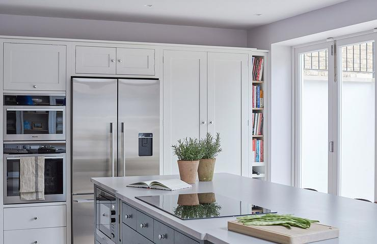 Wall Of Pantry Cabinets With Vertical Cookbook Shelves