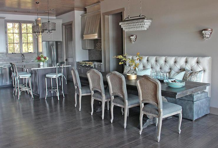 https://cdn.decorpad.com/photos/2015/12/25/gray-dining-room-2-tone-tufted-banquette-french-cane-chairs.jpg