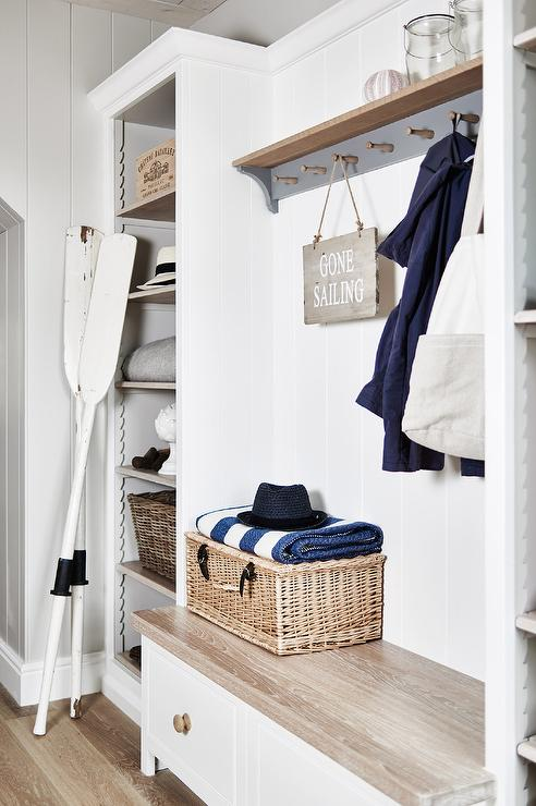 Cottage mudroom with wood top bench and gray coat hooks Mudroom bench and hooks