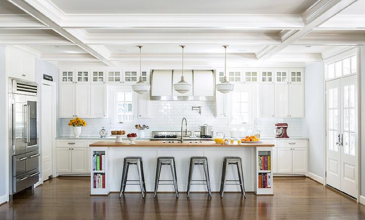 Three Schoolhouse Pendants Illuminate A White Kitchen Island Fitted With  Cookbook Shelves On Either End Topped With Butcher Block Fitted With A Sink  And ...