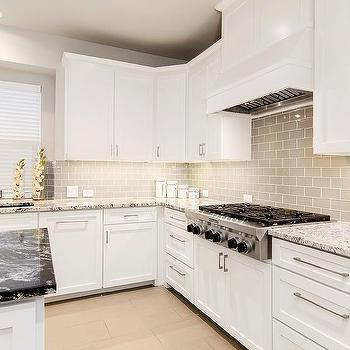 white granite countertops and a gray glass subway tile backsplash