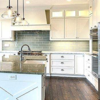 Contemporary White Kitchen With Gray Glass Backsplash