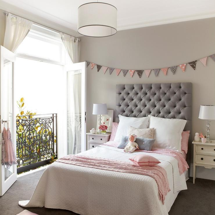 Pink And Gray Girls Bedroom With Banner Over Bed