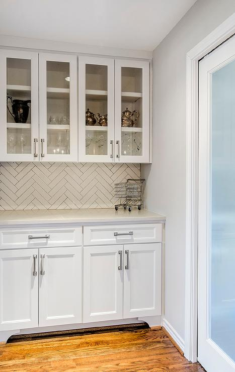 White Butler Pantry With White Herringbone Tile Backsplash