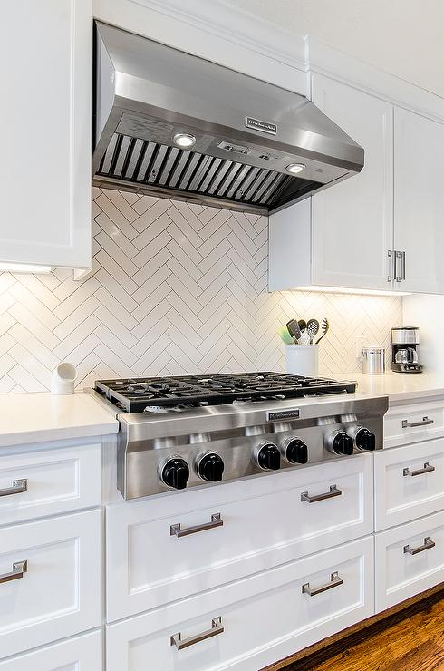 white herringbone kitchen backsplash tiles transitional kitchen