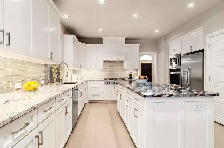 White Kitchen with Gray Glass Backsplash and Granite Countertop ...