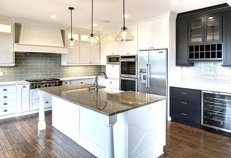 White Kitchen with Gray Granite Countertops and Gray Subway Tiles
