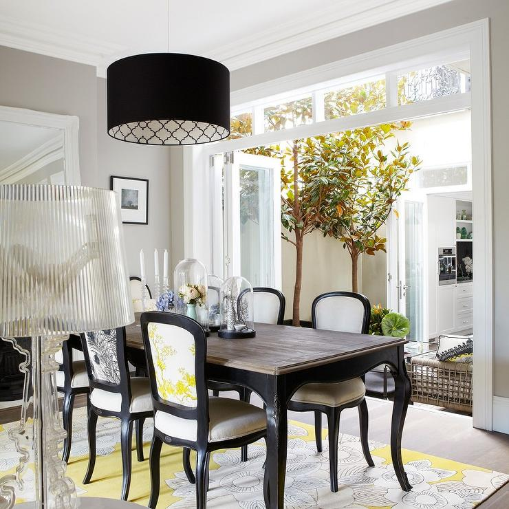 Yellow And Black Dining Room With French Table