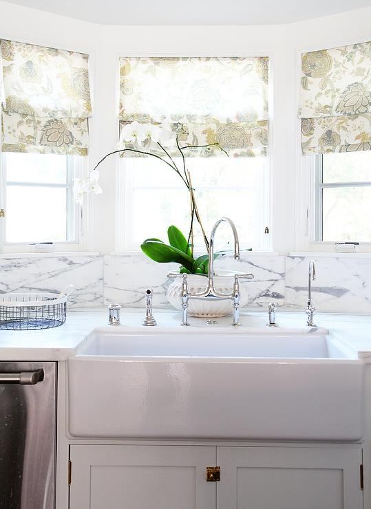 Kitchen bay window sink with floral roman shades for Roman shades for kitchen windows
