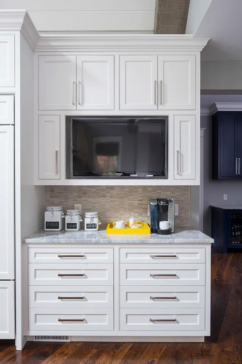 Silver gray limestone tiles with a wood grain like texture for Tv in kitchen design