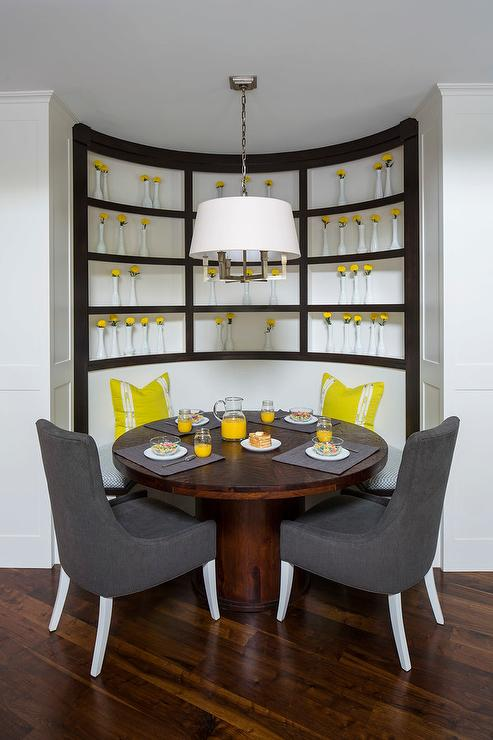 Round Breakfast Room With Gray Curved Banquette And Nixon Dining Table
