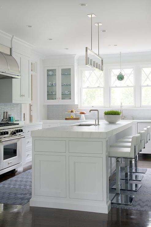 White Kitchen Island With Thick Marble Countertop And