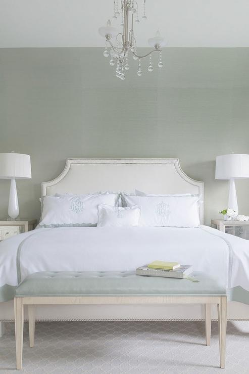 White and Gray Green Bedroom with Crystal Droplets Chandelier Over ...
