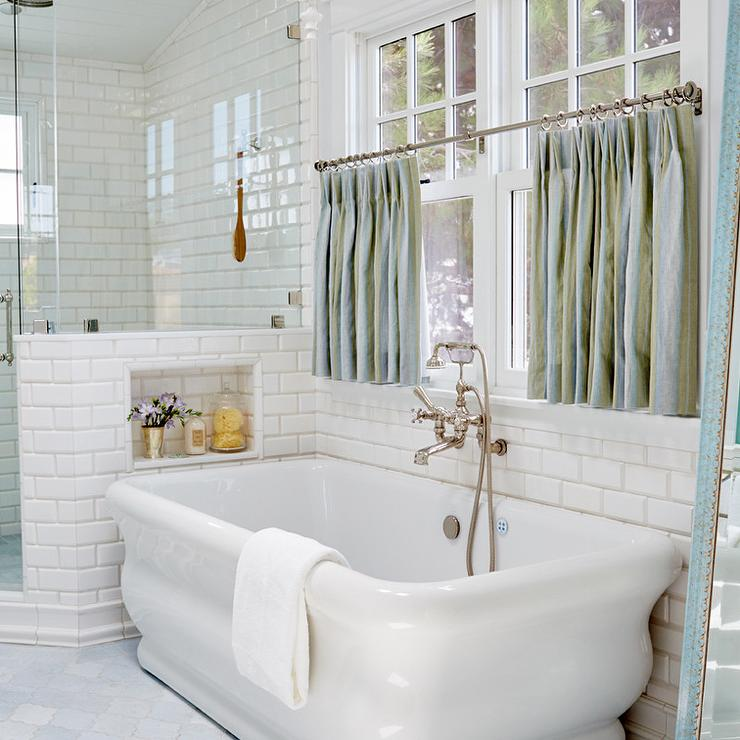 Freestanding tub under window dressed in blue cafe Bathroom window curtains