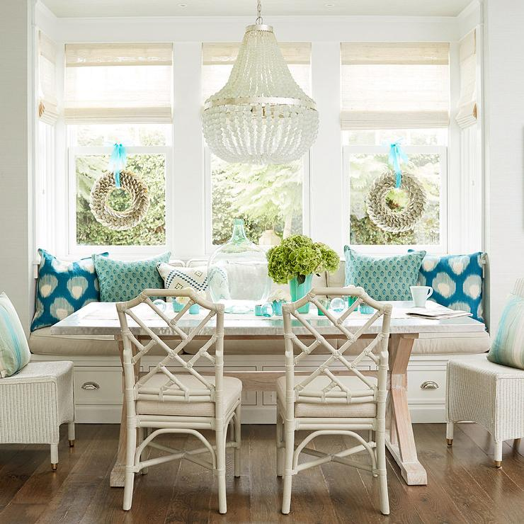 Charmant Ivory And Turquoise Blue Dining Room Features A Built In Banquette Window  Seat Lined With A Taupe Cushion And Turquoise Pillows Facing A Trestle  Dining ...