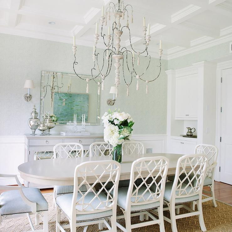Chic Dining Room Features A Large French Candle Chandelier Illuminating Gray Oval Table Lined With White Lattice Back Chairs Accented