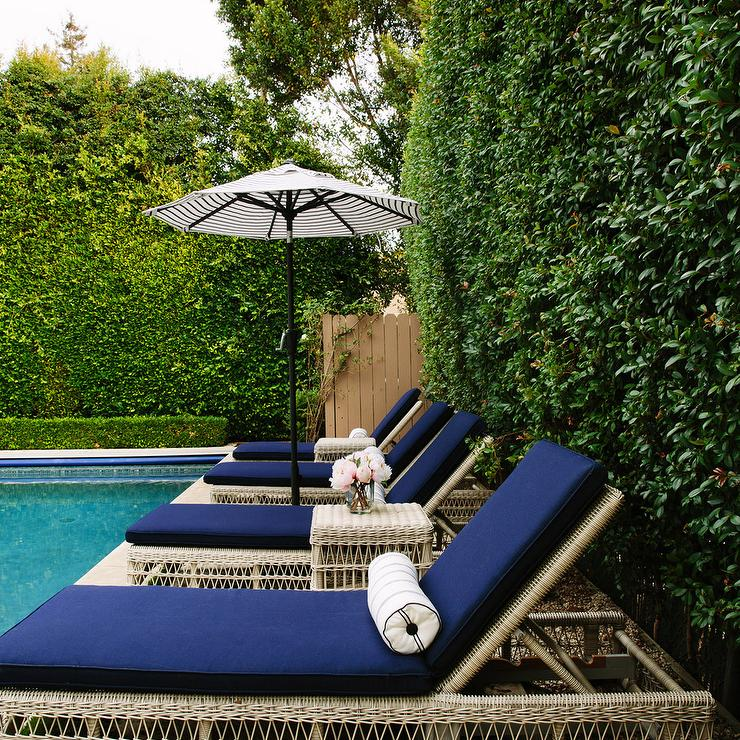 Navy Pool Loungers With Black And White Umbrellas