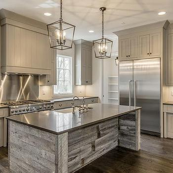 gray shiplap kitchen hood with stainless steel cooktop
