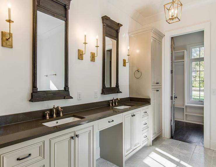 Gold And Gray Bathroom Features A Long Gray Washstand Topped With Dark Gray  Quartz Fitted With His And Hers Sinks And Antique Brass Vintage Style  Faucets ...