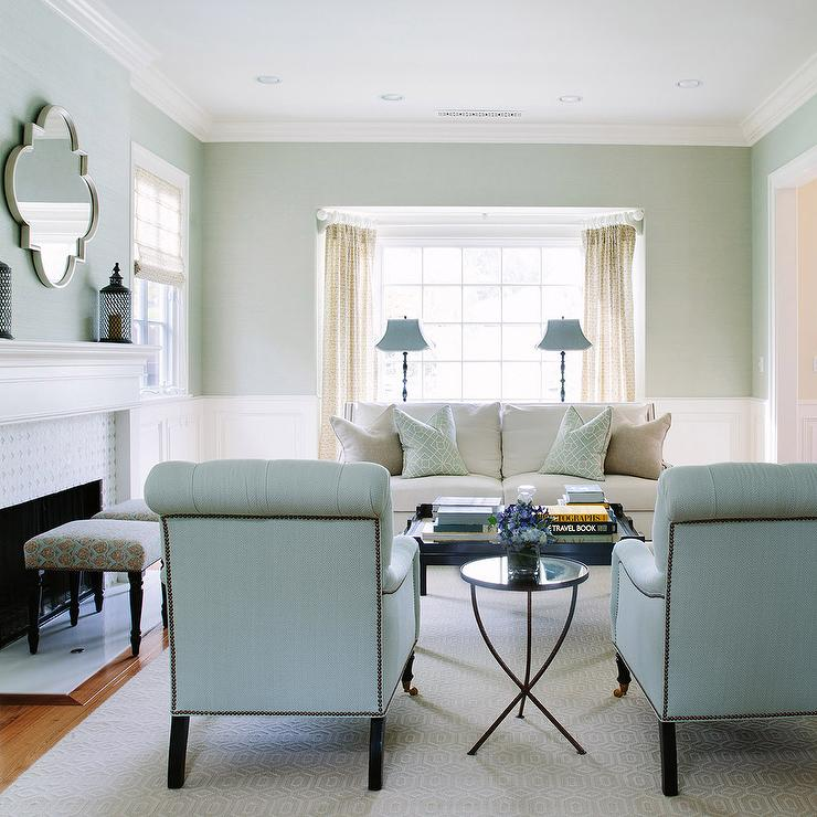 White And Blue Living Room Features Upper Walls Painted Lower Clad In Wainscoting Fitted With A Bay Window Filled Sofa Lined