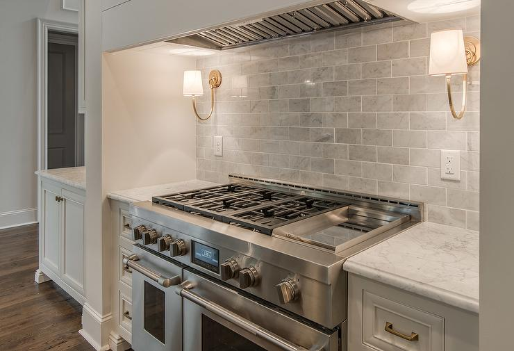 Reed Single Sconces On Gray Marble Backsplash Over Stove Cottage Kitchen