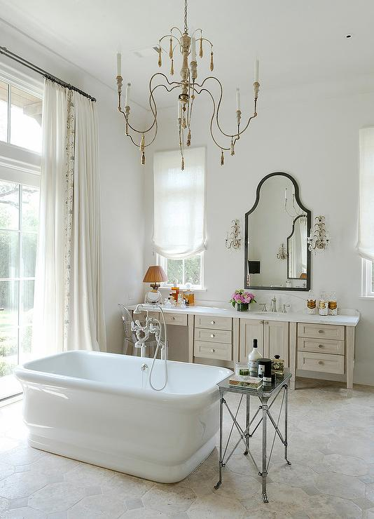 French bathroom with mirror and brass wall sconces for A bathroom in french