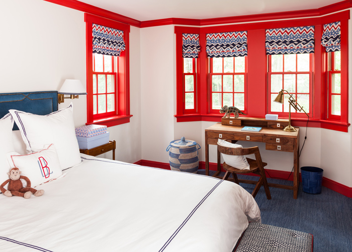 red and blue boys bedroom with desk under bay window
