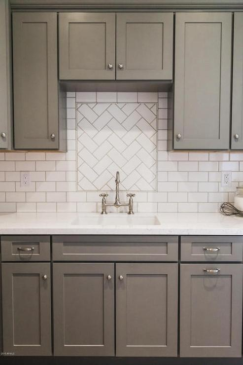 Gray Shaker Kitchen Cabinets With White Subway Tile Herringbone Sink  Backsplash
