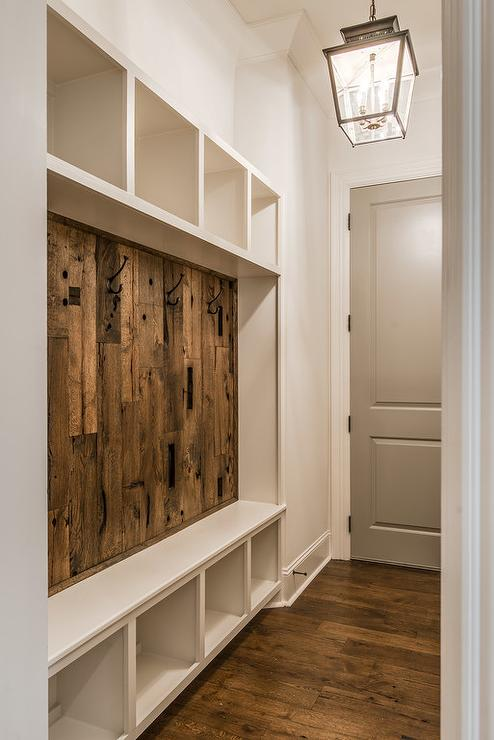 Rustic Mudroom With Barn Board Backsplash Cottage