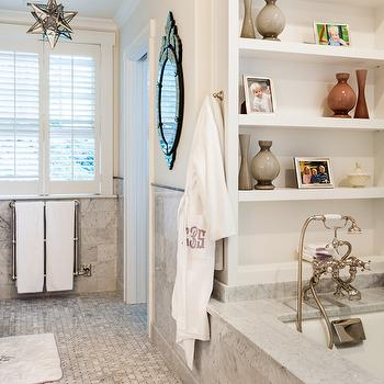 White and gray marble bathroom with mercury glass moravian star pendant