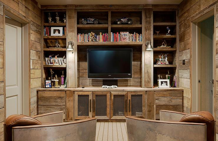 Rustic Family Tv Room Features A Full Wall Fitted With Reclaimed Barn Wood Built In Shelves Surrounding Flat Panel Atop Metal Grille Media Cabinets