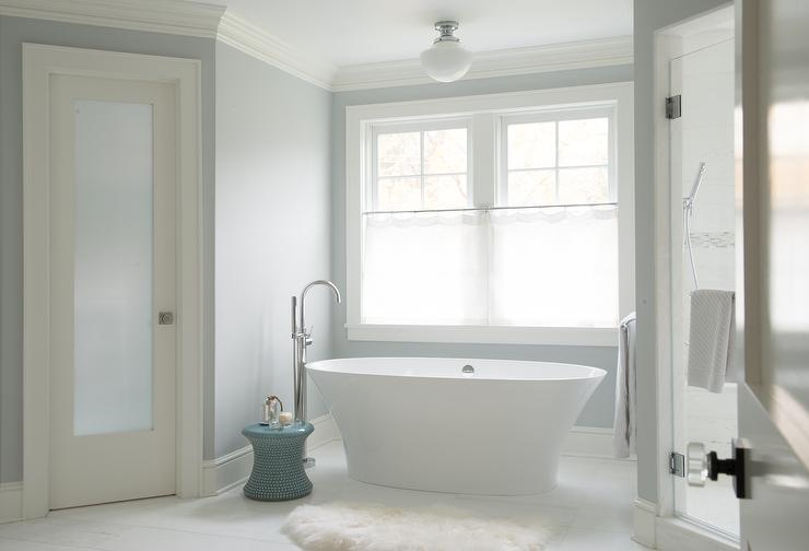 White And Gray Bathroom With Schoolhouse Flush Mount Over Oval Tub