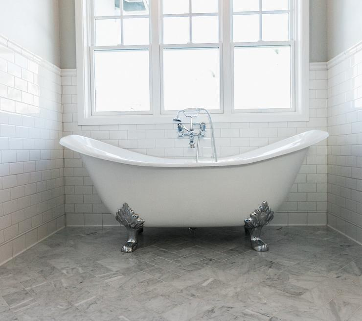 Silver Claw Foot Tub With Gray Marble Herringbone Tile