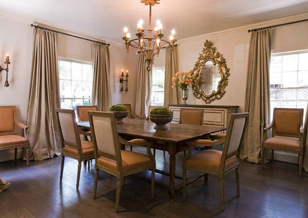 Taupe And Orange French Dining Room Features A Candelabra Chandelier Illuminating Table Lined With Square Back