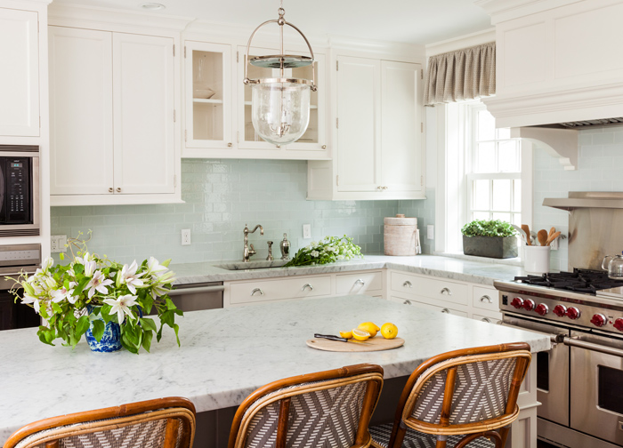 white kitchen with turquoise blue glass brick tile backsplash