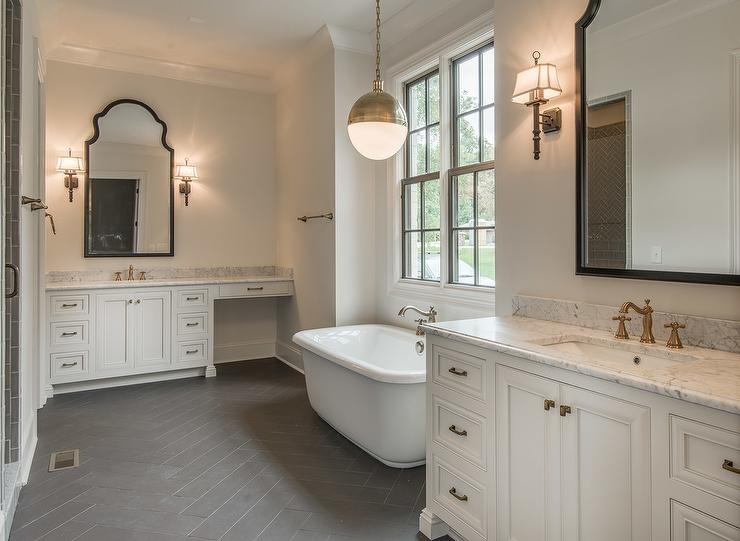 White and gold bathroom features separate his and her washstands boasting  white cabinets adorned with brass knobs topped with white marble fitted  with a. Pottery Barn Bianca Mirror Design Ideas