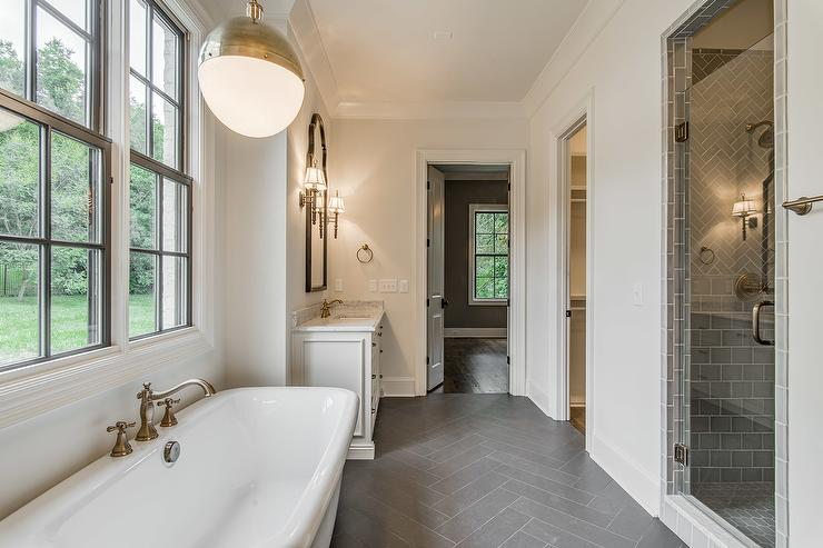 White Bathroom With Dark Gray Herringbone Tile Floor Transitional