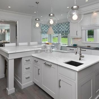 Gray Kitchen Island With Statuary Marble Countertops